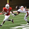 Phoenix special photo by John Hasler<br /> Fort Gibson's Jesss Sanchez gets around the tackle attempt<br /> of Sallisaw's Brody Nicholson during Friday's game in Fort Gibson, The Tigers lost to the Black Diamonds 42-14.