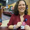 Staff photo by Cathy Spaulding<br /> Creek Nation Casino electronic games manager Amy Walters proudly wears a pin proclaiming she's a two-year survivor of breast cancer.