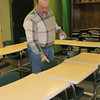 Staff photo by Cathy Spaulding<br /> Muskogee High School ag teacher Ronald Oehlschlager adjusts a chair in his classroom. He said he likes to keep the room orderly.