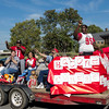Special photo by Travis Sloat<br /> The Bacone College Alumni Association coordinated the majority of Bacone's weekend homecoming events and are seen here with the football players in the parade.