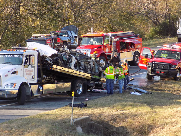 Staff photo by Mike Elswick<br /> Oklahoma Highway Patrol, Mountain View Fire Department<br /> and Morgan Towing workers are seen at the site of a Monday morning two-vehicle fatality crash on Oklahoma 16 west of Muskogee. The wreck happened about 8 a.m. just west of the Old Taft Road turnoff on Oklahoma 16.