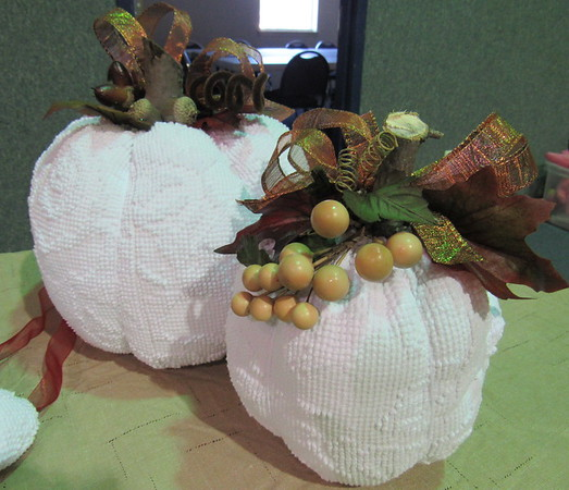 Staff photo by Cathy Spaulding<br /> Stuffed pumpkins made with chenille are among items for sale Saturday at the United Methodist Women's arts and crafts show.
