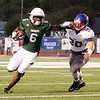 Phoenix special photo by Shane Keeter<br /> Muskogee's Molijah Gilbert, left, stiff arms Bixby's Cade Cannon out of the way during last Friday's game on Creek Nation Field at Indian Bowl. Propelled by the Roughers' 45-42 win over the Spartans, Muskogee climbed into the top spot in Class 6A Division II of the Associated Press' Oklahoma prep football poll for the first time since the early part of the 2006 season.