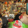 Staff photos by Cathy Spaulding<br /> Matt Hiller shows the variety of masks available at the costume shop, open during the Castle of Muskogee's Halloween Festival.