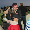 Staff photo by Cathy Spaulding<br /> Fort Gibson All School homecoming queen Destini Walkingstick hugs her brother, Nathan Walkingstick, after her coronation Friday night.
