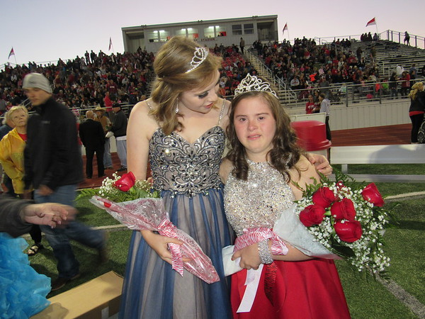 Staff photo by Cathy Spaulding<br /> Fort Gibson High School soccer queen Kali Keeley, left, congratulates Destini Walkingstick for being crowned FGHS All School Homecoming Queen on Friday. Walkingstick, representing Special Olympics, was chosen by a school vote.