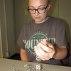 Staff photo by Cathy Spaulding<br /> Oktaha 4-H Club member Georgia Perry pours pull tabs on a table. Muskogee County 4-Hers are partici- pating in a statewide pull tab collection campaign to benefit Ronald McDonald House Charities.