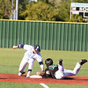 Phoenix special photo by Samuel Perry<br /> Oktaha's Brock Rodden, left, applies the tag to a Tushka runner attempting to steal second during Friday's Class A fall baseball semifinal, The Tigers lost 5-0.