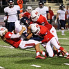 Phoenix special photo by John Hasler<br /> Fort Gibson's Justin Cates, left, Brandon Downey and Hunter Lawson, far right, take down Metro Christian's Robbie Johnson during Friday's game at Leo Donahue Tiger Stadium.