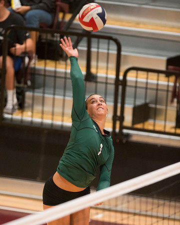 Special photo by Von Castor<br /> Muskogee's Claire Farmer hits a shot at the net against Jenks on Thursday in the Class 6A regional tournament finals.