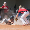 Special photo by Von Castor<br /> Wagoner's Madyson Robertson, left, over-slides third while Hilldale's McKenzie Plant waits to apply the tag Thursday afternoon in the 4A regional final at Lady Hornet Field.