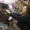 Staff photo by Cathy Spaulding<br /> Billie Flinn operates an old cash register once used by her parents in their wholesale business. She said her parents owned Noblin Wholesale for many years.