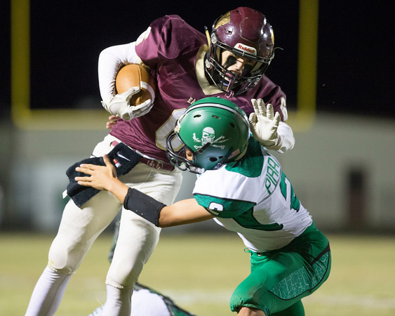 Special photo by Von Castor<br /> Warner's Nik Pleas tries to stiff-arm Gore's Kolby Yargee at the end of a long gain Thursday night at Eagles Stadium in Warner.