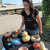 Staff photo by Cathy Spaulding<br /> Britteny Cuevas displays her basketwork for drivers passing the Tiger Art Gallery on Old Shawnee Road.