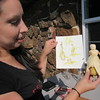 Staff photo by Cathy Spaulding<br /> Britteny Cuevas made a corn husk doll to complement her artwork on the Corn Woman.