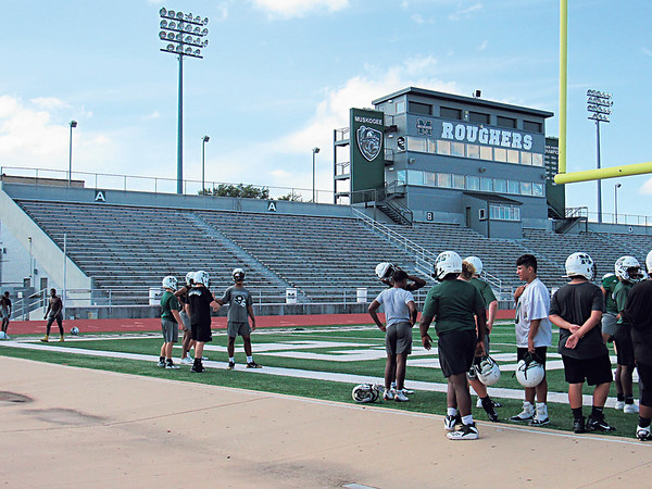 Muskogee High School football players practice at Indian Bowl.