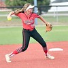 JIM WEBER/Phoenix Correspondent<br /> Hilldale's Celeste Wood fires over to first during the Hornets' 6-1 win over Checotah on Monday. Wood recorded six putouts in the game.