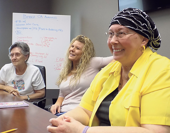 Staff photo by Mike Elswick<br /> Cancer patient Kat C. Fox, right, laughs with her mother, Geraldine Fox, left, and daughter, Treasure McKenzie, center, on a recent visit with  doctors at Landmark Cancer Center in Muskogee.