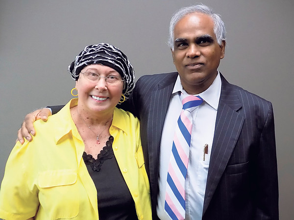 Staff photo by Mike Elswick<br /> Kat C. Fox poses with her medical oncologist Dr. Ravikumar Vasireddy recently at Muskogee's Landmark Cancer Center. She received a breast cancer diagnosis after having a routine mammogram early this year and has been going through radiation treatments.