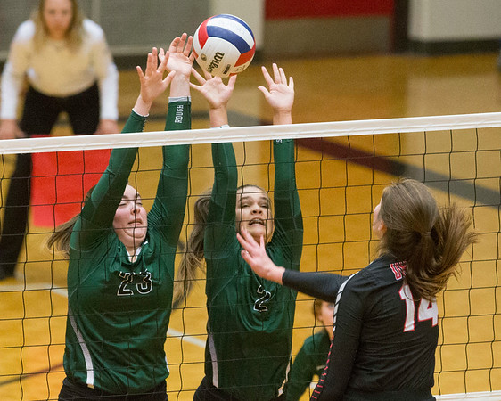 Phoenix special photo by Von Castor<br /> Muskogee's Carson Lamont and Wren Seabolt block a shot from Union's Madi Brown Tuesday afternoon in the 6A regional held at Union.