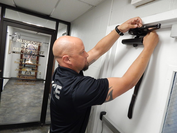 Staff photo by Wendy Burton<br /> Investigator Joe Poffel demonstrates a tactic on securing a door during an active shooter scenario — one of several tactics individuals can learn during upcoming free sessions for the public the Muskogee Police Department is planning. In addition, the department will schedule free training sessions for groups at businesses, schools, churches etc.