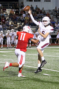JOHN HASLER/Phoenix special photo Fort Gibson's Brayden Morgan closes in on the Muldrow quarterback in last week's win on homecoming night.