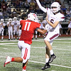JOHN HASLER/Phoenix special photo<br /> Fort Gibson's Brayden Morgan closes in on the Muldrow quarterback in last week's win on homecoming night.