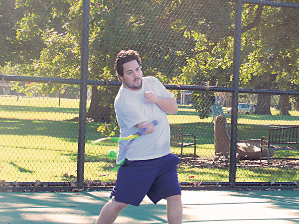 CATHY SPAULDING/Muskogee Phoenix<br /> T.O. Speaks returns a serve during a Wednesday afternoon pickup tennis<br /> match at Spaulding Park. Plenty of sunshine is expected Thursday, according to the Accu-Weather website for Muskogee.<br /> Showers could<br /> move in by the<br /> weekend.