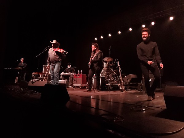 """CHESLEY OXENDINE/Muskogee Phoenix<br /> Heath Wright of Richocet joins brothers Zach and Colton Swon during a song at the 50th Anniversary Concert celebrating Merle Haggard's """"Okie From Muskogee."""""""