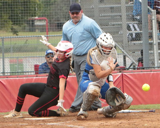 JOHN HASLER/Phoenix Special Photo<br /> Hilldale's Rayna Rock beats the throw to the plate against Vinita for a score on Thursday. Hilldale won 12-0, then beat Broken Bow 9-1 to force a decisive third game for the Class 4A regional tournament championship. That game was suspended in the second inning Thursday and will resume at 1 p.m. Friday.