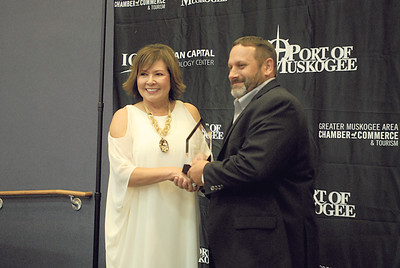 CHESLEY OXENDINE/Muskogee Phoenix Director of Business And Industry Services for Indian Capital Technology Center Kathy Adair presents Owens-Illinois Plant Superintendent Tim Campbell with ICTC's Partner for Progress award for 2018. The award was one of several handed out to businesses and people during Thursday night's Business and Industry Banquet and Awards Ceremony. Story on Page 6.