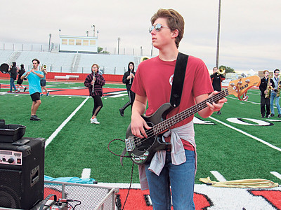 """Justin Dewhurst adds some bass to the Hilldale High School band routine """"Magical Mystery Tour."""""""