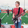 "Justin Dewhurst adds some bass to the Hilldale High School band routine ""Magical Mystery Tour."""