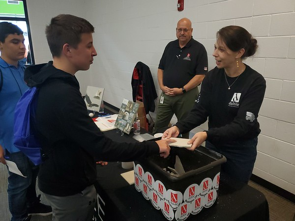 CHESLEY OXENDINE/Muskogee Phoenix Fort Gibson Schools' eighth-grader Jace Austin visits with Dal-Tile representative Elizabeth Webster while checking out some of Dal-Tile's work during the Manufacturing Block Party hosted by the Port of Muskogee Industrial Development Office.