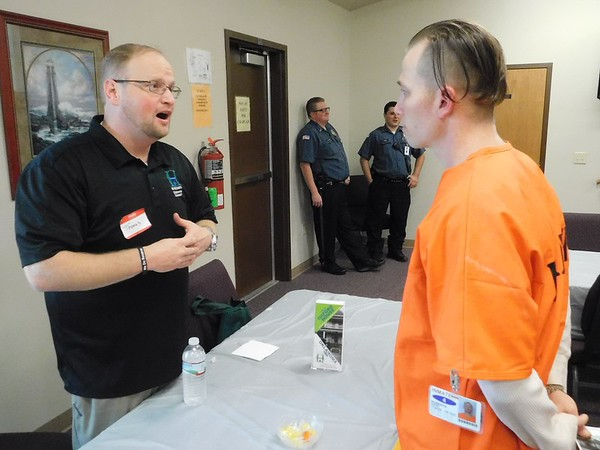 CHESLEY OXENDINE/Muskogee Phoenix Oxford House representative Thomas Floyd speaks with inmate Daniel Roberts during the Oklahoma Department of Corrections Transition Fair held at Eddie Warrior Correctional Facility.