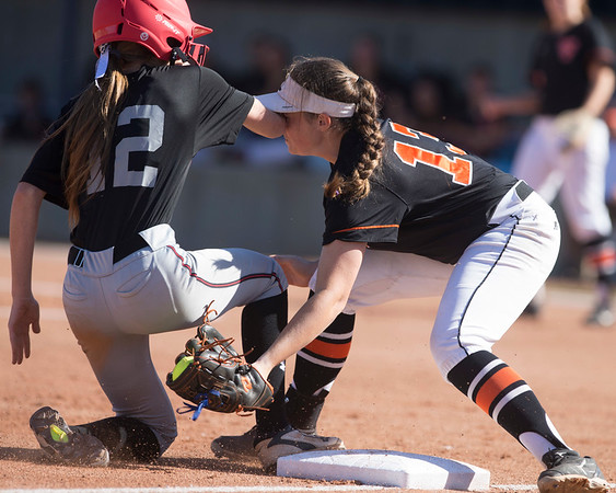 Phoenix special photo by Von Castor<br /> Tahlequah's Betty Danner applies the tag and takes an elbow to the face from Carl Albert's Madison Gaiski in the Class 5A state tourney Thursday in Oklahoma City.