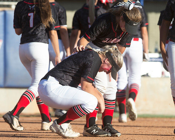 Phoenix special photo by Von Castor<br /> Hilldale's Caitlyn Dowdy consoles senior Abby Isham after the Lady Hornets' 3-1 loss to Bethel in the Class 4A state tournament Thursday in Oklahoma City.