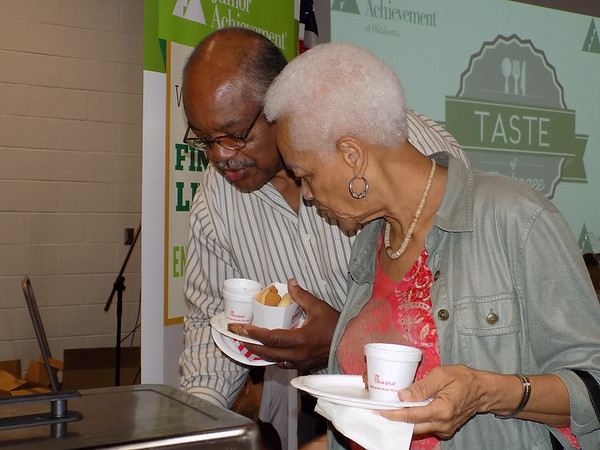 Staff photo by Mike Elswick<br /> Alford and Alneeta Johnson sample the goods at the Rib Crib booth at Thursday's Taste of Muskogee event benefiting Junior Achievement.  The event was held from 5:30 p.m. to 8 p.m. at the Dr. Martin Luther King Jr. Community Center.