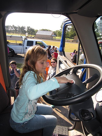 Staff photo by Cathy Spaulding<br /> Creek Elementary student Miley Morgan honks the horn on a semi, one of 20 vehicles displayed at Creek's Transportation Day.