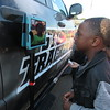 Staff photo by Cathy Spaulding<br /> Creek Elementary kindergartner Londyn Archie gazes at his image while learning about Von Castor's Storm Tracker truck Friday morning during Transportation Day.