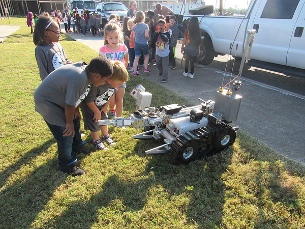 Staff photo by Cathy Spaulding<br /> Creek Elementary students react to a camera on an Oklahoma Highway Patrol bomb-hunting robot Friday morning The OHP brought the robot, a boat and motorcycles to Creek for Transportation Day.