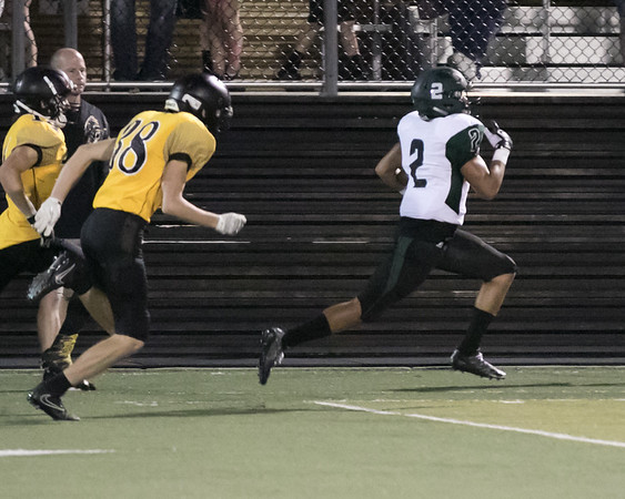 Phoenix special photo by Shane Keeter<br /> Muskogee's Diante Crutchfield, right, breaks away from the Sand Springs kickoff coverage team for a 98-yard return for the go-ahead TD in the Roughers' 40-34 win on Friday in Sand Springs.