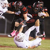 Phoenix special photo by Von Castor<br /> Hilldale's Alex Puckett runs over Metro's Griffen Campbell and gets a block from Brock Owensby on the opening kickoff Friday night against Metro Christian at Hornet Field. The Hornets won 35-7 to remain tied with Fort Gibson atop the District 4A-4 standings.