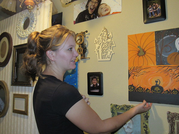 Staff photo by Cathy Spaulding<br /> Amber Tucker has loved to paint since she was a child. She hangs this pumpkin-filled painting during Halloween.