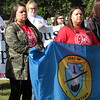 CATHY SPAULDING/Muskogee Phoenix<br /> Sisters Britton Cunningham and Lawren Cunningham hold an Osage Nation flag for ceremonies during Indigenous Peoples Day, observed Monday at Honor Heights Park.
