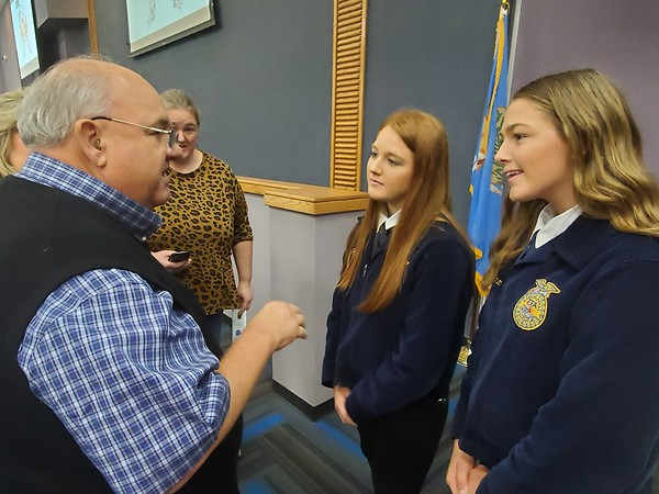 CHESLEY OXENDINE/Muskogee Phoenix<br /> Rancher Joey Newton speaks with honorees Kaylee and JoDawn Herriman during the Agri-Business Appreciation Dinner held at Indian Capital Technology Center on Tuesday night.