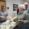 CHESLEY OXENDINE/Muskogee Phoenix<br /> Kathey Pratt of Runt's serves a salad to Linda Nichols during the Agri-Business Appreciation Dinner held at Indian Capital Technology Center on Tuesday night.