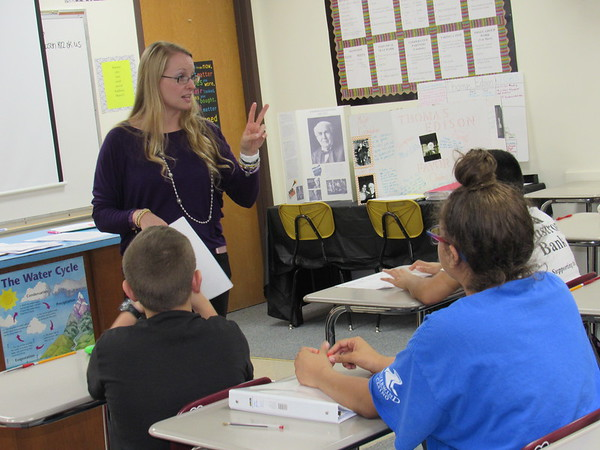 Staff photo by Cathy Spaulding<br /> Middle School counselor Heather Adney discusses conflict resolution options during a class in the Aggressors, Victims and Bystanders anti-bullying program.