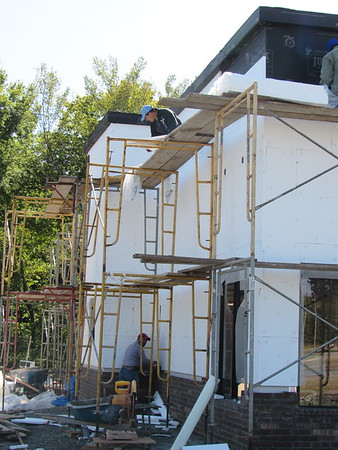 CATHY SPAULDING/Muskogee Phoenix<br /> Contractors do masonry and other exterior work Wednesday on a Tropical Smoothie Cafe. The business could open around mid-November at 1102 W. Shawnee Bypass, said franchise owner and manager Dalton Rhoden. He said he expects to hire 25-30 employees. The restaurant will offer smoothies, quesadillas, sandwiches, wraps and salads. Rhoden said he frequented the restaurants in Oklahoma City while he attended Oklahoma Baptist University.
