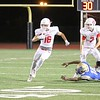 Phoenix special photo by John Hasler<br /> Fort Gibson's Carter Lawson, left, looks for yardage against Tulsa Rogers.